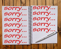 Sorry word. On note pad royalty free stock image