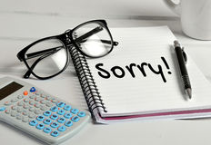Sorry word. On notebook page Royalty Free Stock Photos
