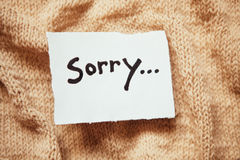 Sorry word on white paper with vintage background Royalty Free Stock Photography