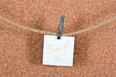 Sorry word written on a piece Stock Images