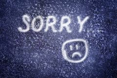 Sorry. Words Sorry : on the abstract grunge dark navy background Royalty Free Stock Image