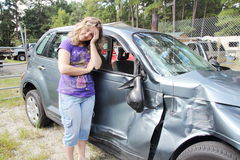 Sorry wrecked car. Girl head ache wrecked her car stock photos