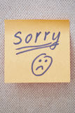 Sorry written on a sticky note Royalty Free Stock Photography