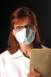 Sorry, you're contagious!. Female physician wearing a breathing mask royalty free stock photos
