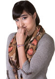 Sorry Young Female. Apologetic mixed woman with scarf biting fingernails Stock Photography