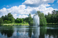 Sorsapuisto park. Located at Tampere, Finland. There is water fountain on Sorsalampi pond. Photo taken on summer holiday time royalty free stock photo