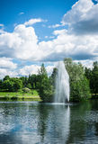 Sorsapuisto park. Located at Tampere, Finland. There is water fountain on Sorsalampi pond. Photo taken on summer holiday time royalty free stock photography