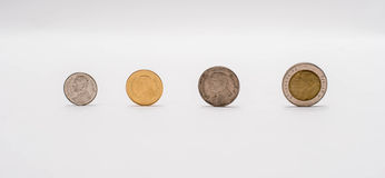 Sort baht coins. Focus baht coins arranged on a white background Stock Photography
