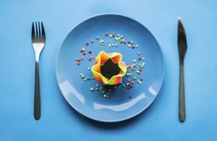 Sort of colorful food on blue plate stock photos