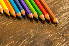 Sort crayons flooring surfaces, bright colors, red, yellow, blac. K, orange and green Stock Photos