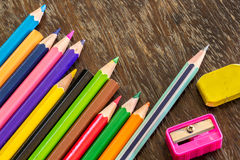 Sort crayons flooring surfaces, bright colors, red, yellow, blac. K, orange and green Royalty Free Stock Photography