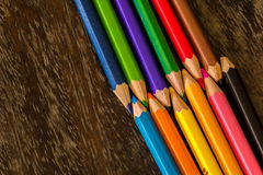 Sort crayons flooring surfaces, bright colors, red, yellow, blac. K, orange and green Stock Images