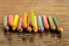 Sort crayons flooring surfaces, bright colors, red, yellow, blac. K, orange and green Stock Photo