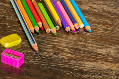 Sort crayons flooring surfaces, bright colors, red, yellow, blac. K, orange and green Stock Photography