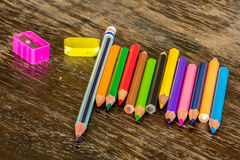 Sort crayons flooring surfaces, bright colors, red, yellow, blac. K, orange and green Royalty Free Stock Images
