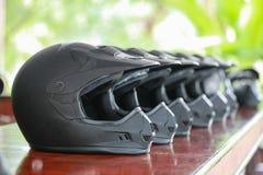Sort Helmet. The row of black Helmet Stock Image