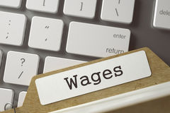 Sort Index Card Wages. 3D. Wages Concept. Word on Folder Register of Card Index. Archive Bookmarks of Card Index on Background of White PC Keyboard. Closeup Stock Photo