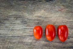 Sort red tomato queen. On a wooden table Stock Photography