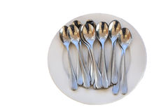 Sort spoon in plate. With isolated Royalty Free Stock Images