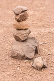 Sort stones to renew their faith.  Royalty Free Stock Photo