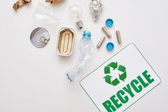 Sort your garbage. Crumple foil, paper and plastic royalty free stock image