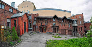 Sortavala Buildings and Architecture. Wide angle panorama of red brick dwelling houseon back yard in Sortavala, Republic of Karelia, Russia royalty free stock photos
