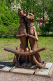 Sortavala, Republic of Karelia, Russia - June 12, 2017: A bench in the form of the Art object -Dog and cat-. Sortavala, Republic of Karelia, Russia - June 12 royalty free stock photos