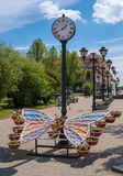 Sortavala, Republic of Karelia, Russia - June 12, 2017: Public garden with a city clock and a decorative flower bed. Decorative flower bed is made in the form stock images