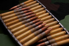 Sorted ammo on military background Stock Photo