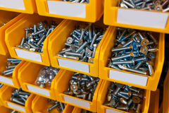 Sorted bolts in boxes in the store Royalty Free Stock Photos