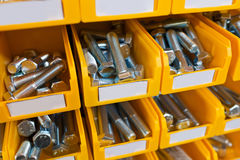 Sorted bolts in boxes in the store Royalty Free Stock Photography