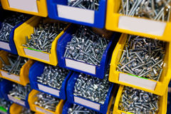 Sorted bolts in boxes in the store Stock Photography