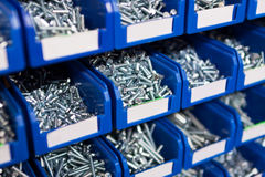 Sorted bolts in boxes in the store Royalty Free Stock Images
