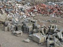 Sorted Building Rubble. Piles of building rubble are sorted into type royalty free stock images