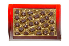 Sorted chocolate candies box. Isolated on white Stock Photos