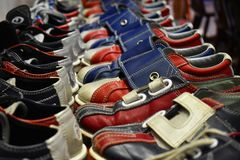 Sorted shoes for bowling in red blue and white color royalty free stock image
