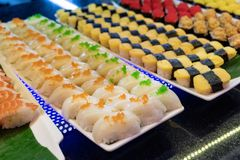 Sorted of variety sushi with fish, shrimp, egg with rice on tray. In restaurant royalty free stock photos
