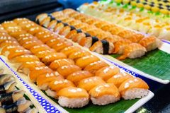Sorted of variety sushi with salmon fish, shrimp, egg with rice on tray. In restaurant stock images