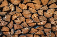 Sorted wood log background texture. Stack of arranged brown wood log background Royalty Free Stock Image