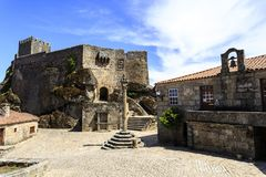 Sortelha – Medieval Pillory, Town Hall and Castle. View of the Manueline pillory built in the 16th century 1510 in front of the town hall and prison at royalty free stock photography