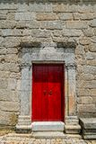 Sortelha historical mountain village, built within Medieval fortified walls, included in Portugal`s Historical village. Route. Bright red church door entrance stock photos