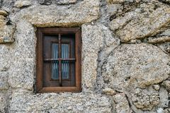 Sortelha historical mountain village, built within Medieval fortified walls, included in Portugal`s Historical village. Route. Manueline style window frame royalty free stock photo