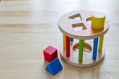 Sorter toy on wood background. Copy space Stock Photos