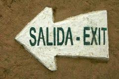 Sortez le bilingue de flèche de signe de signal de Salida Images stock