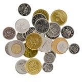 Sortierte Münzen auf weißem Hintergrund Lizenzfreie Stockfotografie