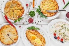 Sortiment av georgian traditionell mat, lekmanna- lägenhet Arkivfoto