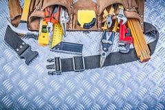 Sortiment av konstruktion som bearbetar i läderbyggnadsbälte på c fotografering för bildbyråer