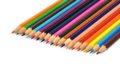 Sortiment av kulöra blyertspennor över vit Royaltyfria Bilder