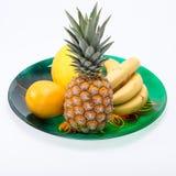 Sortiment av nya exotiska frukter som isoleras på vit Royaltyfri Bild