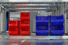 Sorting bins shelf. Plastic bins for sorting at shelf in storage room royalty free stock photography